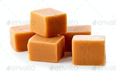 caramel candies on white background