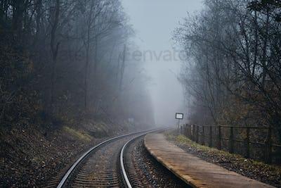 Railway in mysterious fog