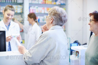 Customers been waiting on the queue in drug store