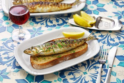 sardinhas assadas, portuguese grilled sardine on toasted bread