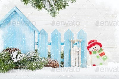 Christmas snowman and sledge toys and fir tree branch