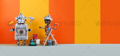 Two funny mechanical toys artists with paint rollers, wooden ladder and buckets.
