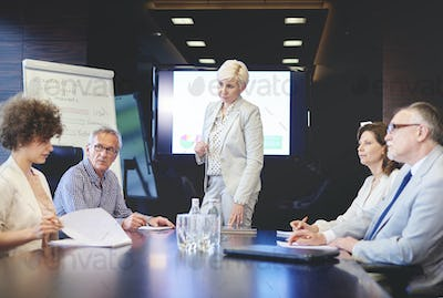 Woman as a chairman on the business meeting