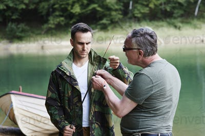 Friends make preparations for fishing