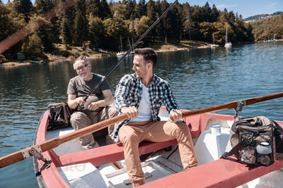 Two men spending time together on the lake