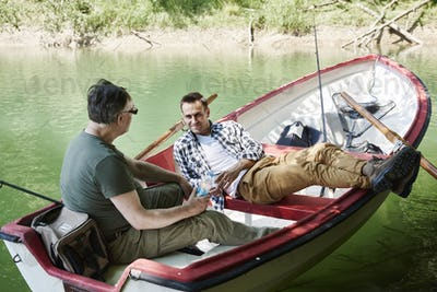 Fishermen sitting and relaxing in boat
