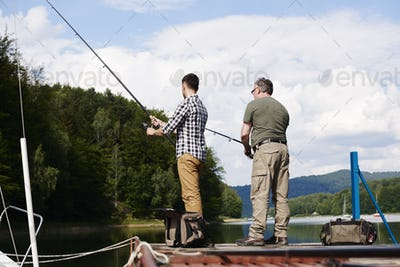 Rear view of men fishing