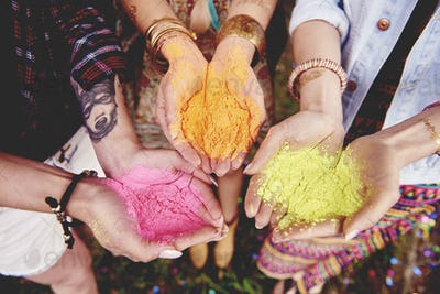 Holi colors in hand of women