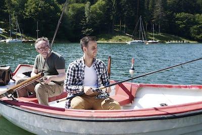 Men fishing in a lake