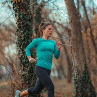 Attractive Woman Jogging. Nature, Outdoors