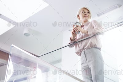 Businesswoman drinking coffee while a short break