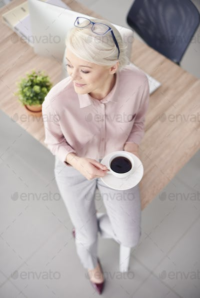 Smart business person with coffee sitting at desk