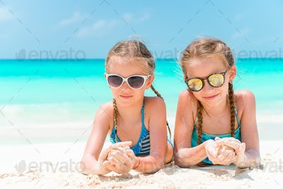 Portrait of two beautiful kids looking at camera background of beautiful nature of blue sky and