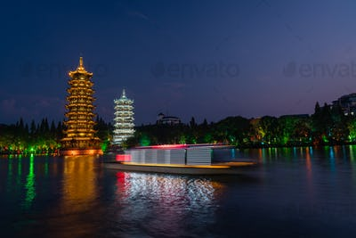 Sun and Moon Pagodas Towers at night