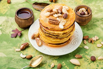 Plate with tasty pancakes