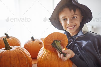 Boy and big open pumpkin