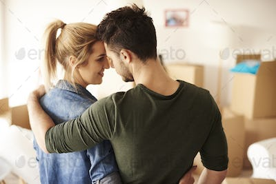 Romantic view of couple cheering in new home