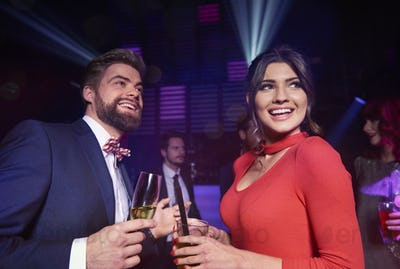 Cheerful couple spending time together at night club