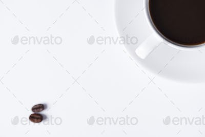 Defocused cup of coffee on white background