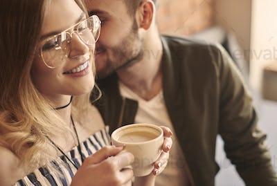 Man flirting with girlfriend in cafe bar