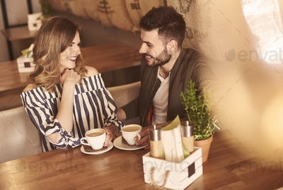 Young couple during meeting in cafe bar
