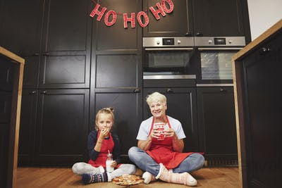 Portrait of grandmother and granddaughter in kitchen
