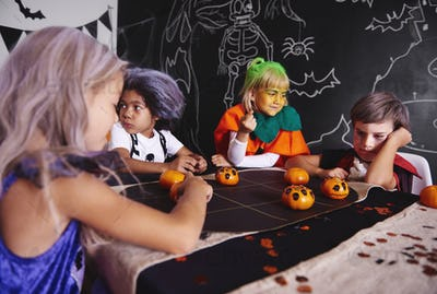Kids playing games while halloween party