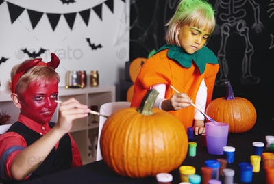 Shot of pumpkins being painted by kids