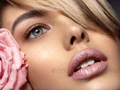 Beautiful young fashion woman with light pink lipstick. Beauty m
