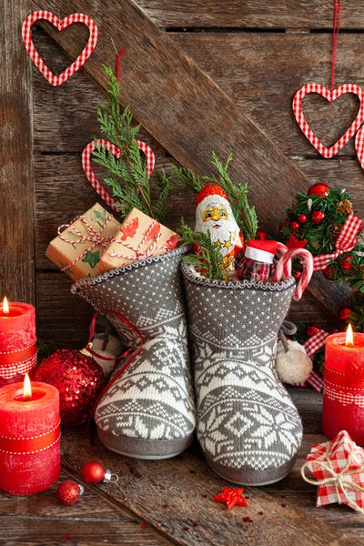 Knitted boots with candy and Christmas presents