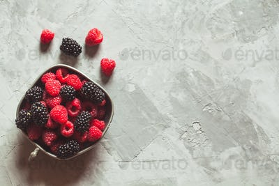 Fresh berries raspberries, blackberries on a gray art background. Healthy food, summer berries