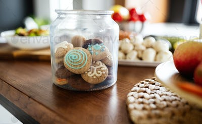 Beautiful tasty cookies in jar on kitchen table