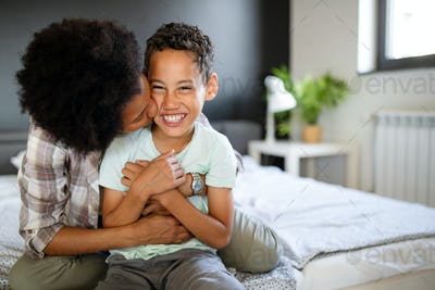 Happy young african american mother having fun with her child