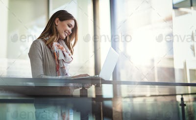 Beautiful young woman working as a freelancer on laptop