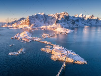 Aerial view of small islands, bridge over the sea and mountains