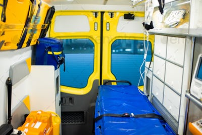 Interior of contemporary ambulance car with stretcher and medical equipment