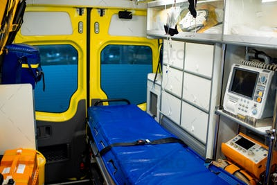 Interior of ambulance car with stretcher, refrigerator and medical equipment