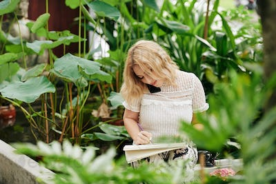 Woman drawing flowers and plants