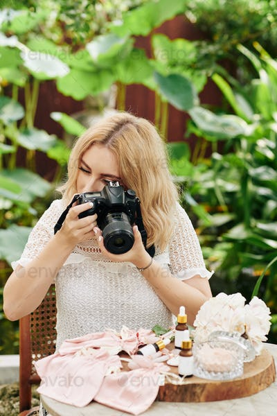 Photographer taking photos of beauty products