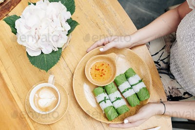 Plate with spring rolls and sauce