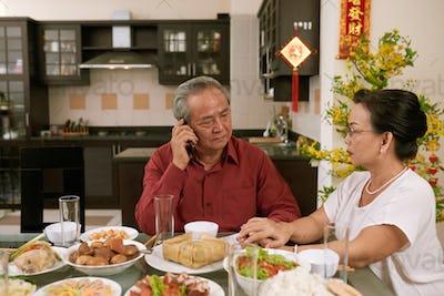 Senior couple receiving disturbing phone call