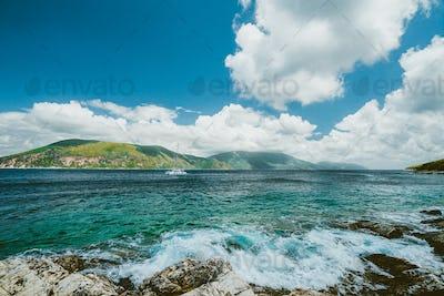 Beautiful cloudscape near Fiskardo, Kefalonia, Ionian islands, Greece. Crystal clear transparent
