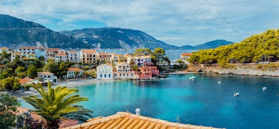 Scenic panoramic view of Assos village on summer morning, Kefalonia island. Summer luxury tourism