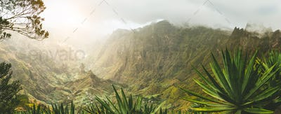 Agave plants and rocky mountains in Xoxo valley in Santo Antao island, Cape Verde. Panoramic shot