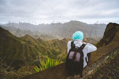 Traveler enjoying magnificent view of huge mountain range on Santo Antao island, Cape Verde