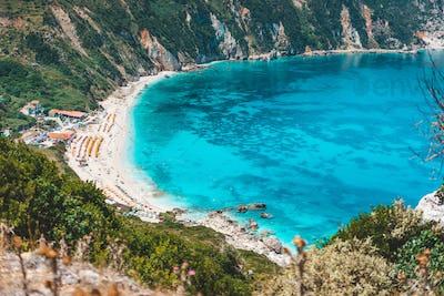 Myrtos beach with azure blue sea water in the bay. Favorite tourist destination to visit in summer