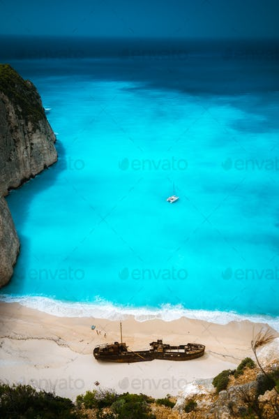 Shipwreck in Famous Navagio beach. Azure turquoise sea water and paradise sandy beach. Tourist