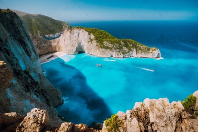 Navagio beach, Zakynthos island, Greece. Tourist boats visiting Shipwreck bay with azure water and