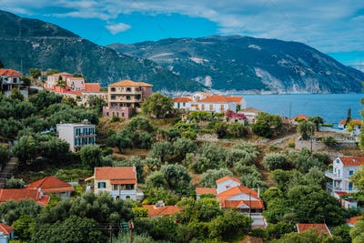 Cozy town, relaxing, summer feeling. Red roofs of Assos village at the lush green Mediterranean