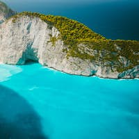 Navagio beach with Shipwreck on the beach with turquoise water. Famous landmark location of